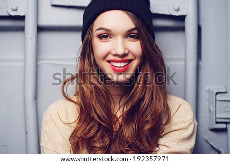 Portrait of a beautiful brunette girl outdoors in hat, lifestyle #192357971