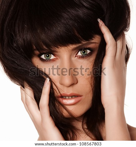 portrait of a beautiful brunette girl with short hair and bright colored makeup,  photographed in the studio against a plain white background