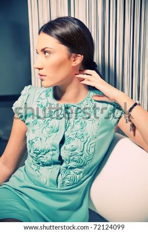 Portrait of a beautiful brunette in a stylish fashion dress