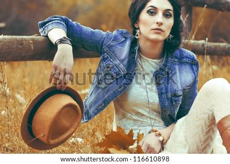 portrait of a beautiful brunette in autumn park