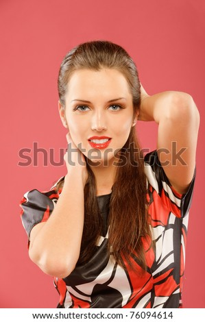 Portrait of a beautiful brunette on a red background