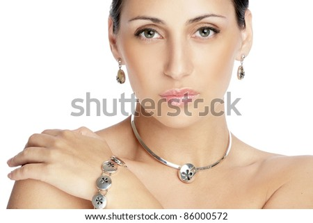 Portrait of a beautiful brunette woman against white background