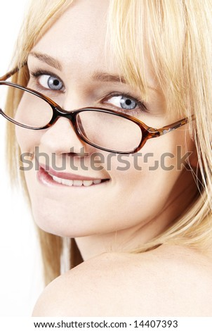 Portrait of a beautiful brunette woman with light grey eyes looking over her shoulder wearing glasses