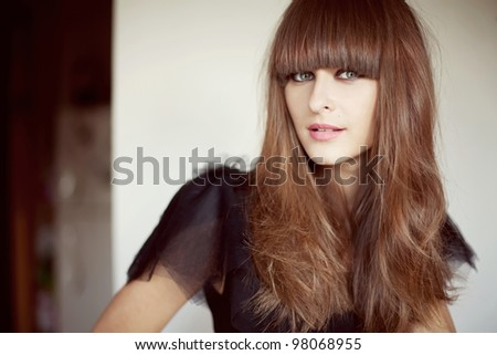 portrait of a beautiful brunette woman with long hair and makeup