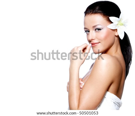 Portrait of a beautiful brunette women with a white lilly