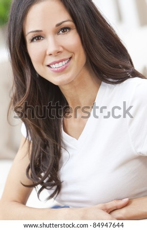 Portrait of a beautiful brunette young woman with perfect teeth smiling and relaxed