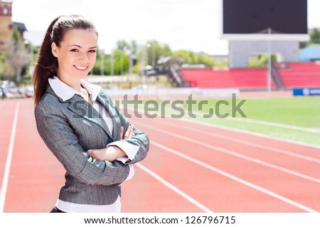 portrait of a beautiful business woman at a sports stadium, the competition in the business