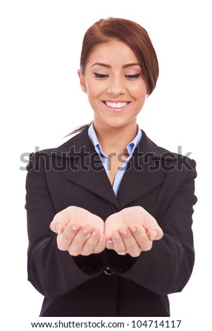 Portrait of a beautiful business woman holding something on her hand,  Isolated on white background
