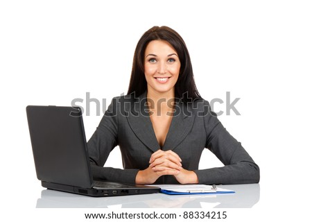 Portrait of a beautiful business woman smile sitting at the desk looking at camera working isolated over white background