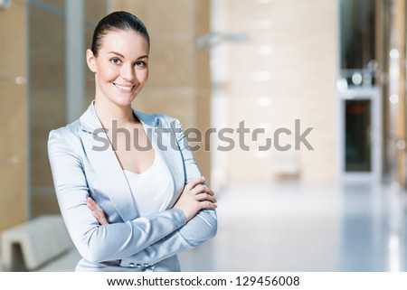 portrait of a beautiful business woman, smiling and crossed her arms