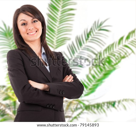 Portrait of a beautiful businesswoman. Plant in the background.