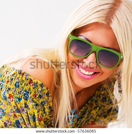 Portrait of a beautiful cheerful blonde in green sunglasses
