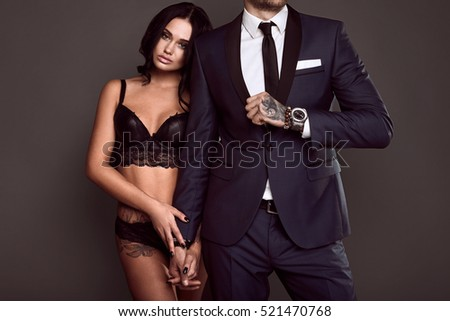 5e711eb23f Portrait of a beautiful couple  brutal man in elegant suit and sexy girl  with a