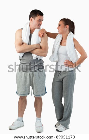 Portrait of a beautiful couple going to practice sport against a white background