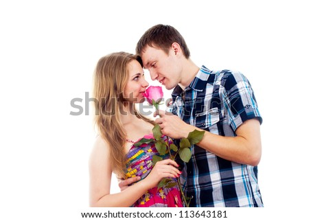 portrait of a beautiful couple in love with a rose