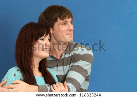 portrait of a beautiful couple on a blue background