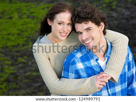 Portrait of a beautiful couple smiling outdoors