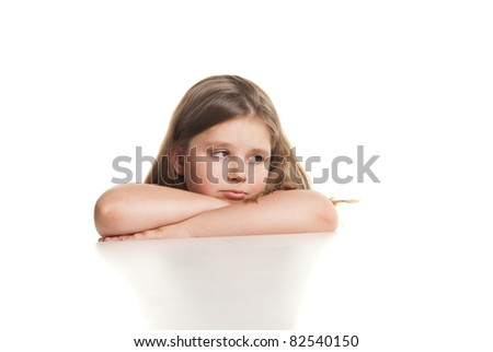 Portrait of a beautiful crying girl over white background