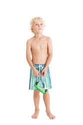 Portrait of a beautiful curly blond European boy wearing swimming shorts. Boy is looking up. Studio shot, isolated on white background.