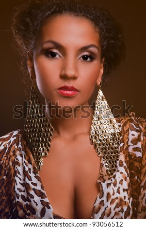 portrait of a beautiful dark-skinned elegance woman in the studio