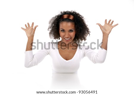 portrait of a beautiful dark-skinned woman with hands up in a white dress in the studio