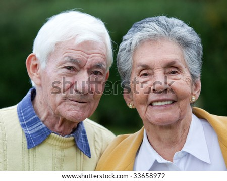 Portrait of a beautiful elder couple smiling outdoors