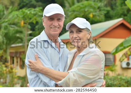 Portrait of a beautiful elderly couple standing embracing outdoors