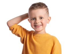 Portrait of a beautiful European boy 6 years old on a white background. The blue-eyed child is smiling broadly, his hand behind his head. Children's emotions.