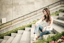 Portrait of a beautiful european woman sitting om steps