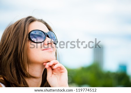 Portrait of a beautiful european woman smiling outdoors