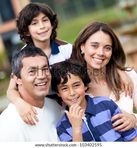 Portrait of a beautiful family smiling and looking happy - outdoors