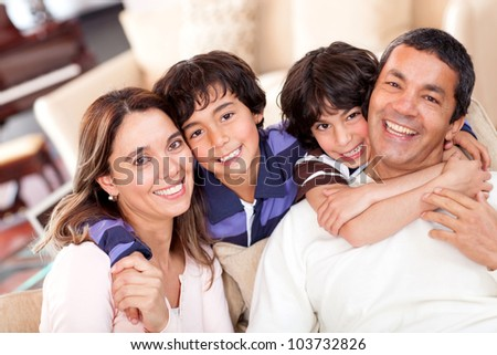Portrait of a beautiful family smiling at home