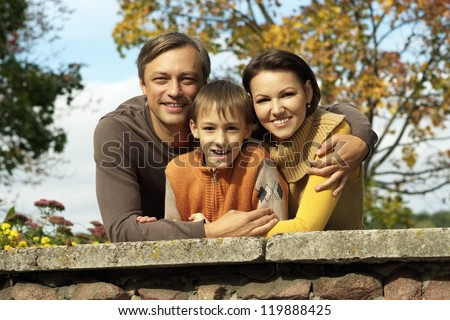 portrait of a beautiful family together relaxing in autumn