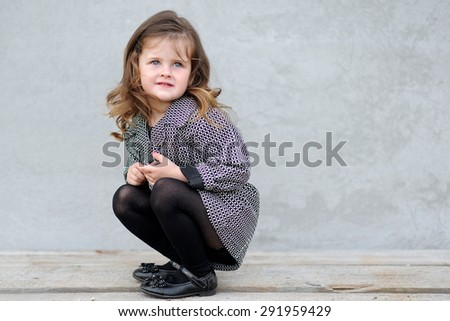 Stock Photo portrait of a beautiful fashion little girl