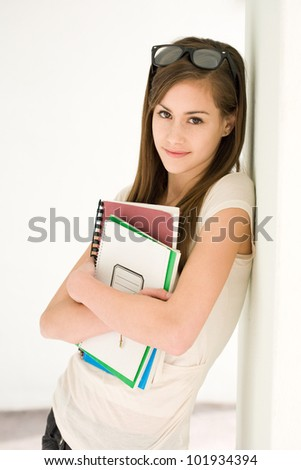 Portrait of a beautiful fashionable young brunette student girl.