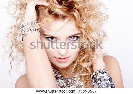 portrait of a beautiful female model on white background with diamond jewelry