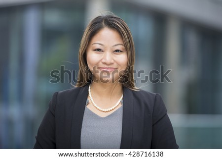 Portrait of a beautiful Filipino businesswoman in smart business suit. #428716138