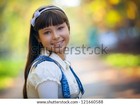 Portrait of a beautiful girl close-up