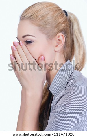 Portrait of a beautiful girl  covers her face with her �¢??�¢??hands