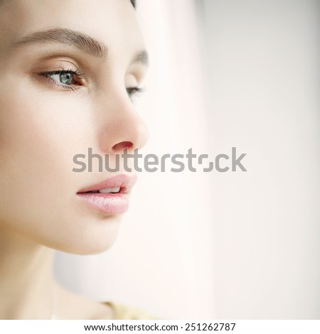Portrait of a beautiful girl face close-up, concept of health and beauty