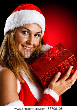 Portrait of a beautiful girl holding a Christmas present
