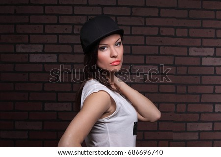 portrait of a beautiful girl in a baseball cap #686696740