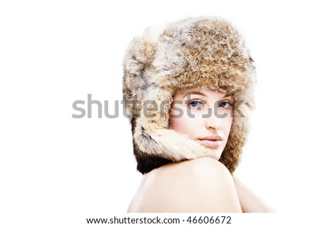 portrait of a beautiful girl in a fur russian hat