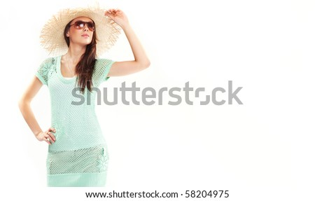 Portrait of a beautiful girl in a summer hat