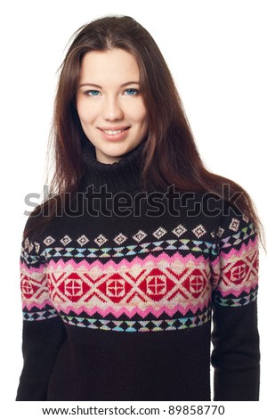 Portrait of a beautiful girl in a warm sweater,  on a white background
