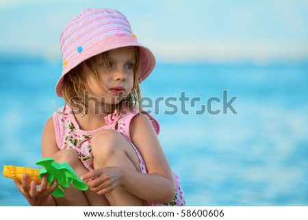 Portrait of a beautiful girl in the blue sea. summer at the beach. Greece, Halkidiki, Kassandra. - stock photo