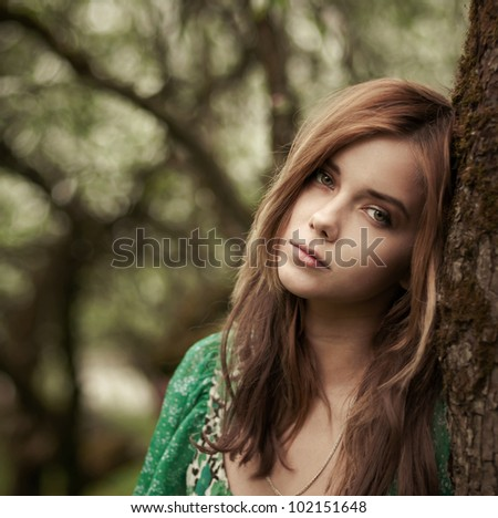 portrait of a beautiful girl in the garden in spring