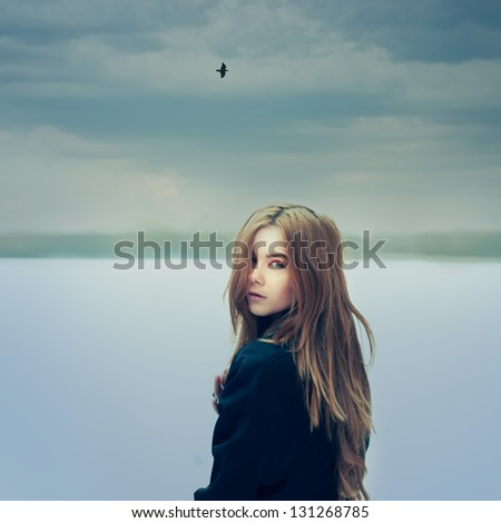 portrait of a beautiful girl on a cloudy day. Photo Gothic