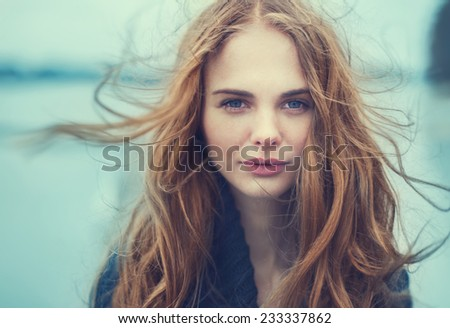 portrait of a beautiful girl on a cold windy day #233337862