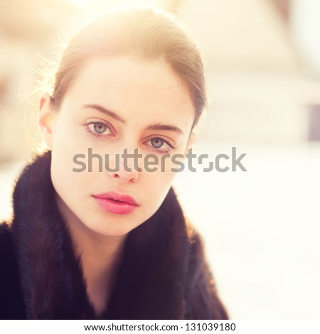 portrait of a beautiful girl on a sunny spring day